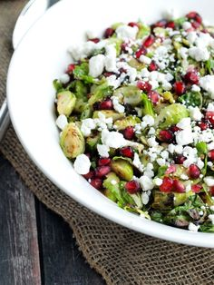 Warm Brussels Sprouts Salad with Pomegranate and Goat Cheese. Think you don't like brussels sprouts? Get ready to fall in love! This is an easy and healthy recipe everyone loves and looks beautiful on a holiday table.