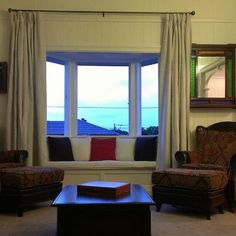 Bay window dressing. Wing back chairs. Long curtains for high ceilings. Queenslander.