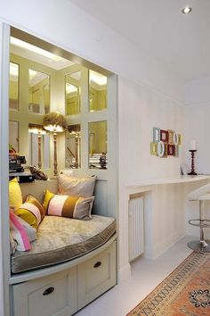 Great use of paneled mirrors to make that nook double the appearance of the space