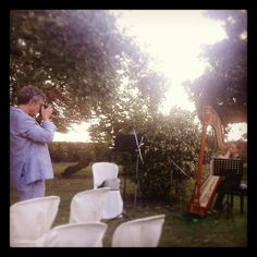 A photographer and an harp player. Both making art