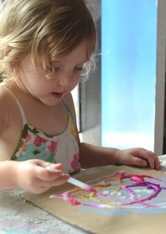 On a paper plate. No waiting for salt to dry...Salt painting is so cool.  Kids love it!