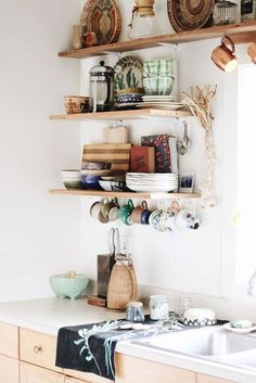 open shelving with eclectic dishware and kitchen accessories. / sfgirlbybay