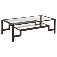 Bring distinctive appeal to your living room with this handsome coffee table, showcasing a curling cast iron base and pen shell inlay. Use the lower shelf to...