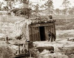 This picture was taken in 1863 near Petersburg, Virginia. It shows a Civil Was Sutler, with his little shop.