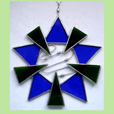 Decorative hanging for window or wall. Can even be hung in the garden on a tree or trellis !
