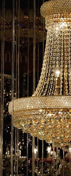 Gold and decadent, this stunning chandelier will add a glamour to any home