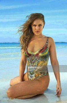 Mixed martial artist and actress Ronda Rousey poses for the 2016 Sports Illustrated swimsuit issue on November 26 2015 in Saint Vincent and The Grenadines. Body painting by Joanne Gair. Ronda Rousey Pics, Ronda Rousey Hot, Ronda Jean Rousey, Rhonda Rousy, Divas Wwe, Sports Illustrated Swimsuit 2016, Swimsuits 2016, Swimwear, Rowdy Ronda