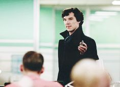 Benedict Cumberbatch as Sherlock Holmes GIF texting and doing the eyebrow! <3