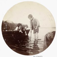 Paddling in the sea: a circular photo taken with a Kodak No.1 box camera used from about 1880