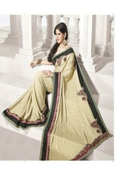 http://rajasthanispecial.com/index.php/womens-collection/sarees/cream-shade-net-saree-with-hand-work.html