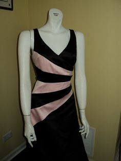 This v-neck, black, satin gown has pink stripes to make you stand out among the crowd.