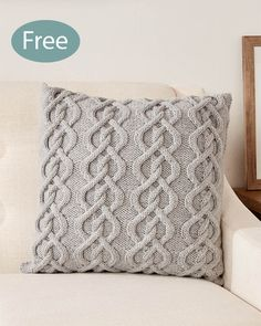 Free Knitting Pattern for Cable Pillow - A 14-row intertwined cable design creates a stunning cushion cover. Designed by Caron. Aran weight yarn.