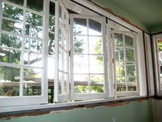 bi-fold windows with grills.  replace large picture window with these.  they'll open the inside to the porch.  {Tar Paper Crane - A Remodeling Blog}