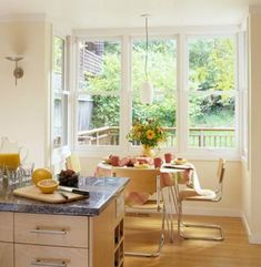 Putting a table and chairs next to a bank of windows is a surefire way to make meals more enjoyable. The light streams over the table, ensuring it will reach all the way to the working areas of the kitchen. Kitchen Nook, Kitchen Dining, Kitchen Ideas, Kitchen Cabinets, Bright Kitchens, Elegant Kitchens, Green Tile Backsplash, Dining Room Windows, Traditional Tile