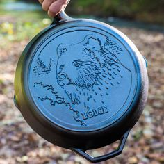 The Lodge Cast Iron Wildlife Series 12 inch brown bear skillet.