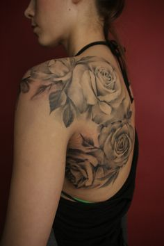 Don't want roses but like the shading, the leaves and the placement across the shoulder.