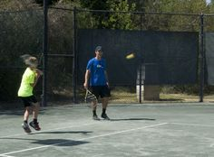 Father and son playing in a Quarter Court Family Tournament at Holly Tree Racquet Club in North Carolina, FUN! #familyfun #tennis