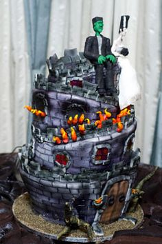 hree tier Frankenstein and his bride wedding cake. Decorated and hand painted to look like Frankensteins castle. Topped with Frankenstein and his bride wedding cake topper. Made By Jessica Thompson of Isabel's Bakery in Sparks, NV (www.isabelsbakery.com)         #wedding #cake #birthday
