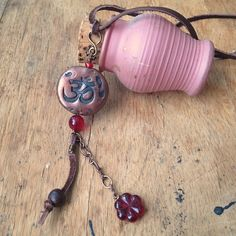 Polymer Clay Stamped OM Pendant with Leather and Copper Beaded Dangle. #OM #Pendant #spiritual #necklace #jewelry #accessories #leather #copper #polymer #clay #sculpey #fimo #handmade