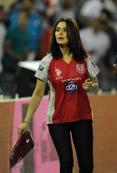 Kings XI Punjab team owner Bollywood actress Preity Zinta distributes t-shirts to spectators during the IPL Twenty20 cricket match between Kings XI Punjab and Pune Warriors at PCA Stadium in Mohali on April 12, 2012.