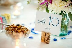 Use corks to hold table numbers or escort cards... Mount Pleasant can save corks for you for your big day!