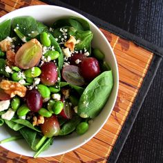 Superfoods salad - spinach, edamame, walnuts, grapes, and gorgonzola. Drizzled in a zesty white wine vinaigrette.