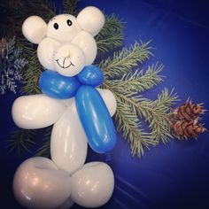 Photo by heatherdnewton Feb 9: Some {details} from #ElevationChurch's 2nd birthday winter carnival - pine bow centerpieces and balloon animal prizes. #fmsphotoaday