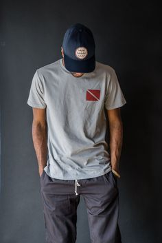 Mollusk s classic diving motif on the front and back of this super soft  100% cotton de319cb166dd