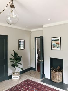 Sometimes you can let the paint do the talking. By painting the doors a dark grey (Downpipe by Farrow and Ball), they become the star of the show. You wouldn't want to do this in a period property if your doors weren't original to the house, but when they Farrow And Ball Living Room, My Living Room, Home And Living, Living Room Decor, Farrow And Ball Kitchen, Cornforth White Living Room, Cornforth White Hallway, Cornforth White Farrow And Ball, Home Interior