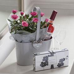 Rosé Wine Plant Gift. Love the mini roses that can be planted and enjoyed long after long stems would have died.