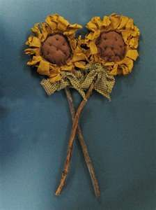 (I seen these at a local primitive shop I go to all the time. They are $17.99 each, I think I can make them myself) primitive sunflowers
