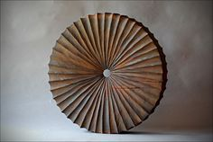 'Roue Cannelee : Grooved Wheel' by French sculptor Benoît Averly (b.1980). Oak and rust, 45 cm. via Zone One Art
