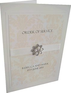 Damask and pearl wedding order of service in ivory and cream