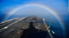 A rainbow forms over the bow of the Nimitz-class aircraft carrier USS John C. Stennis as the ship steams in the Pacific Ocean on February 3, 2015. Click through the gallery to see other U.S. Navy aircraft carriers throughout history.