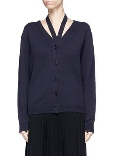 Engineered to create a halterneck impression, this cardigan by Victoria Beckham lends the classic pullover a modern update. Cast in versatile midnight navy, this piece is knitted from wool for a soft feel. Echo runway styling and wear yours with a long flowy skirt and boots.