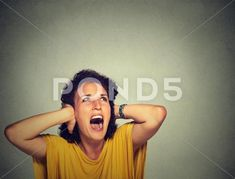 Stock photo Young annoyed unhappy stressed woman covering her ears, looking up, screaming stop making loud noise its giving me headache isolated grey background with copy space. Gray Background, Annoyed, Model Release, Emperor, Looking Up, Scream, Ears, Crushes, Give It To Me