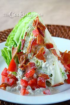 BLT Wedge Salad  •1 head iceberg lettuce, cut into quarters •1 medium tomato, diced •4 strips bacon, cooked, diced Buttermilk Bleu Cheese Dressing: •1 large egg •3 cloves garlic •1 cup vegetable oil •¼ cup buttermilk •½ teaspoon salt •½ teaspoon white pepper •¼ teaspoon cayenne pepper •8 ounces blue cheese, coarsely crumbled...