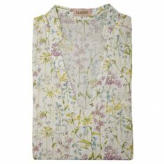A pretty #Liberty print blouse. The print is a delicate floral design. The style is a loose fitting v-neck top with 3/4 length sleeves.