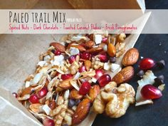 Paleo Trail Mix on www.PopularPaleo.com | Walnuts, toasted coconut chips, dark chocolate pieces and fresh pomegranates!