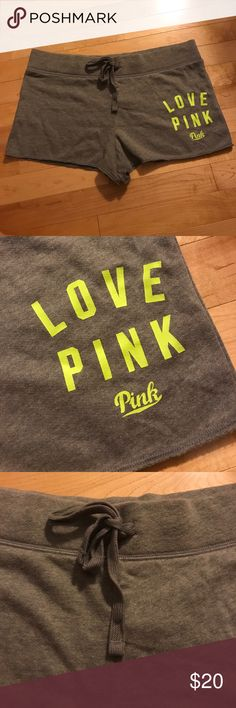 NWT Love Pink grey shorts New with tags never worn. Grey with neon yellow green lettering. See matching sweatshirt also new in my closet. Comes from smoke free home. Bundle to save. Fast shipping!! PINK Victoria's Secret Shorts