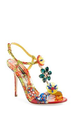 In a delightful, summer-bright mix of exuberant garden prints from Domenico Dolce and Stefano Gabbana, this dazzling T-strap sandal is a bejeweled ode to the famed Italian design house.