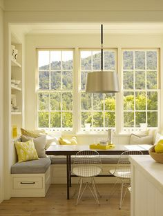 Bay window and bench seating. I'd love a bay window seat. Not necessarily with a table, though. Just one with lots of throw pills and an area to gaze out the window, read, or crochet. :)