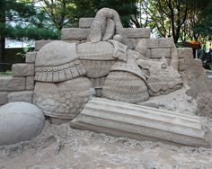 The Sand Sculpture at the 2014 Arts Festival of the Arts. It was carved from 25…