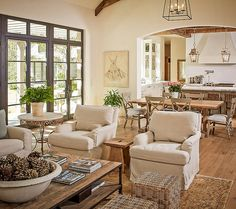 Gorgeous neutral living room with open floorplan to dining and kitchen.