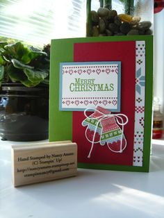 By Nancy Amato (Stampin' All Night).  Stamps: Make a Mitten and Chock-Full of Cheer; Paper: Gumball Green, Raspberry Ripple, Baja Breeze, Whisper White, Snow Festival DSP; Ink/markers: Gumball Green, Raspberry Ripple, Baja Breeze; Mitten Builder punch; Whisper White Baker's Twine