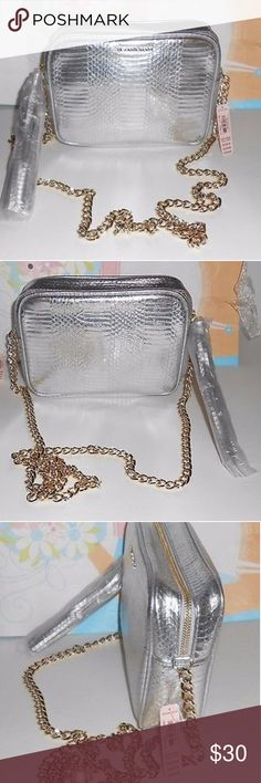 Victoria's  Secret  Purse New with tags and the plastic part covering the tassel is gone but it is new with tags. Cost $70.00 new tags still attached. Victoria's Secret Bags