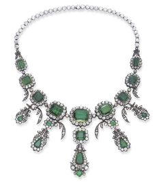 ANTIQUE DIAMOND AND EMERALD NECKLACE.  The front set with a series of nine graduated square, cushion and rectangular-cut emeralds, each within an old mine-cut diamond surround and spaced by diamond collets, suspending five similarly-set diamond and emerald foliate drops. Circa 1840