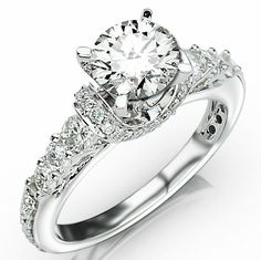 Wouldn't mind this as a 5 year anniversary gift! Prong and Pave Set Designer Diamond Engagement Ring with a 1.5 Carat I-J SI2-I1 Center Stone and 0.9 Carats of Side Diamonds (2.4 Cttw)