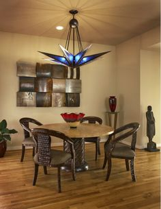 What a unique light/chandelier!  Dining Room - Home and Garden Design Ideas
