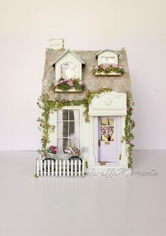"I called my new custom dollhouse La Couturiere. This house is a fresh mint color with a lilac door. The house measures 20 1/2"" high x 14 ..."